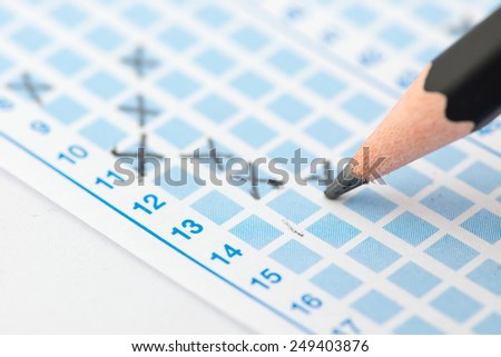 Filled answer sheet focus on pencil - stock photo