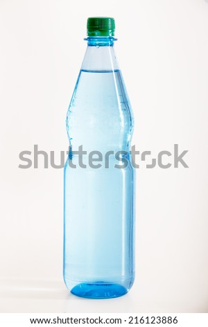 Filled bottle of mineral water - stock photo