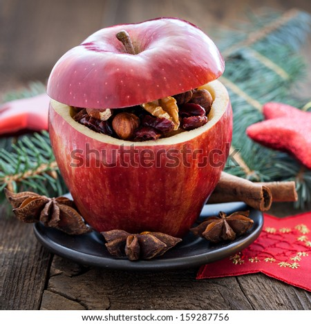 filled christmas apple with raisins and nuts   - stock photo