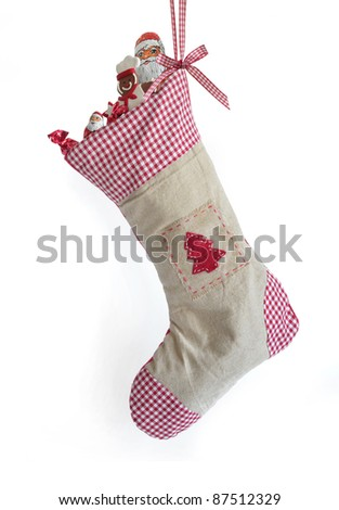 Filled Christmas stocking - stock photo