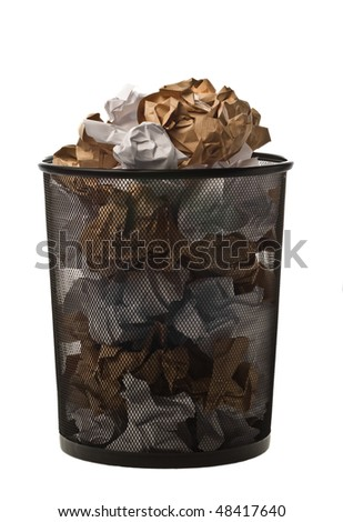 Filled up black metallic office trash basket isolated on white - stock photo