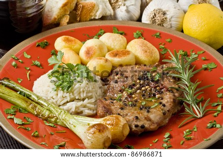 Fillet Mignon with pepper and garlic - stock photo