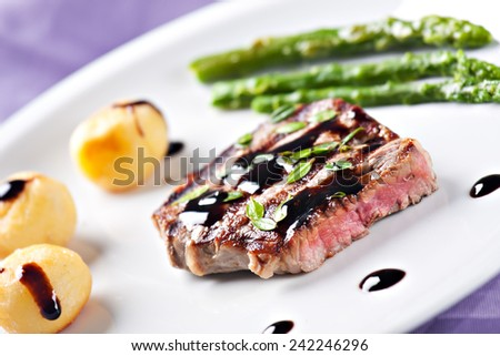 Fillet of beef with asparagus and potateos - stock photo