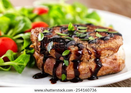 Fillet of beef with mixed salad. - stock photo