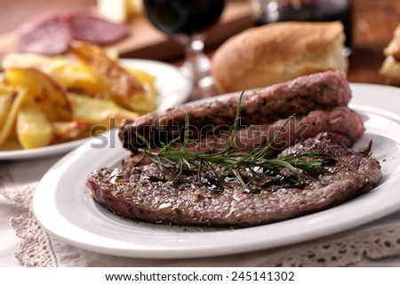 Fillet of beef with sausage - stock photo