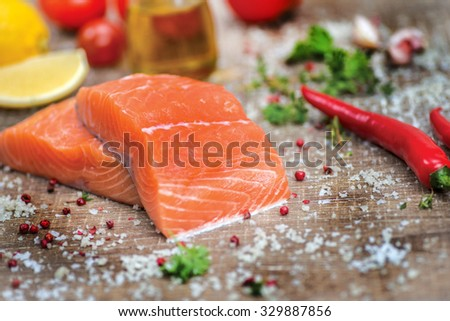 Fillet of salmon. Fresh and beautiful salmon fillet on a wooden table. Delicious fish meat. - stock photo