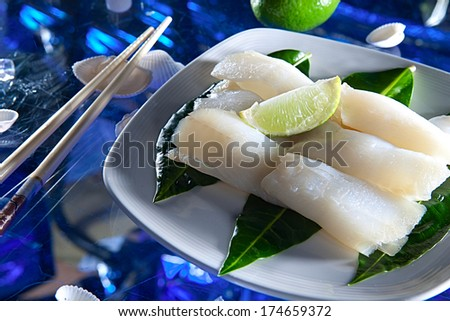 Fillet of turbot on white dish with lime - stock photo