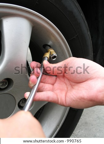 Filling Air Into Car Tyre - stock photo