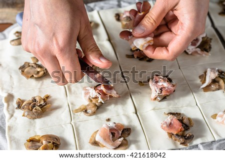 Filling dough with a stuffing, preparing french pastry buns, baking concept