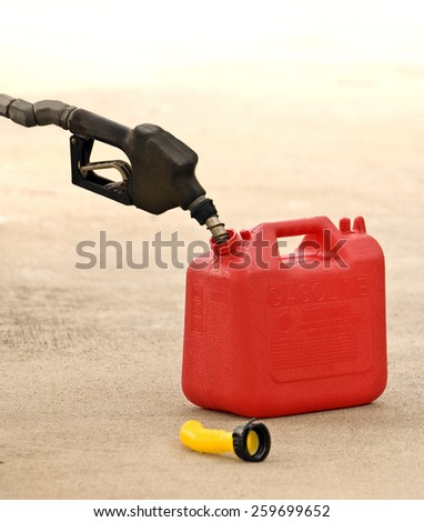 Filling Empty Gas Container - stock photo
