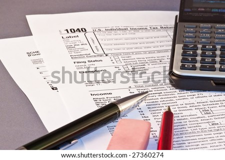 Filling federal individual tax return forms - stock photo