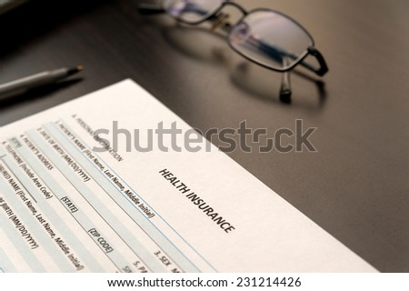 Filling health insurance application - stock photo