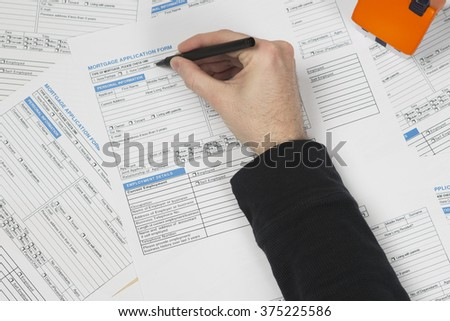 filling in mortgage application form