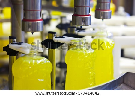 Filling line of liquid chemical products - stock photo
