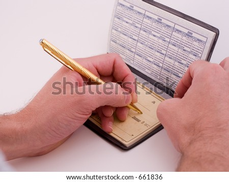 filling out a check - stock photo