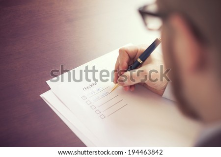 Filling Tasks to Checklist - stock photo