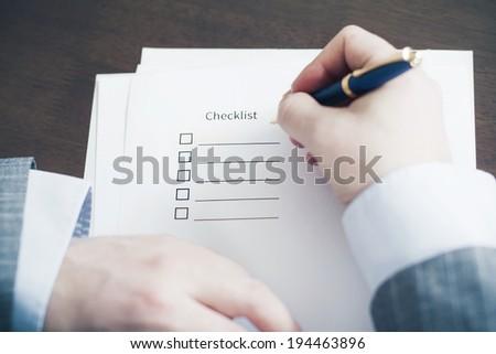 Filling Tasks to Checklist - stock photo