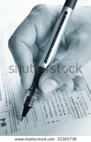 Filling tax form - stock photo