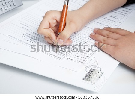 filling the documents. Hand with pen over blank