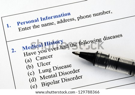 Filling the patient personal information and medical history questionnaire - stock photo