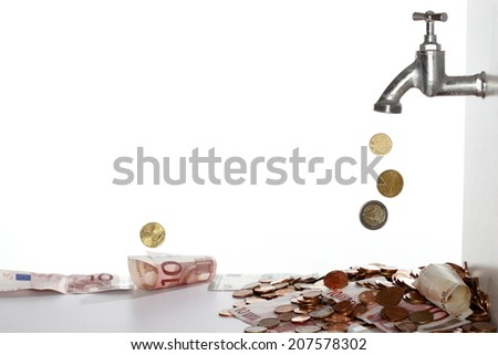 filling up the money with a symbolic plug - stock photo