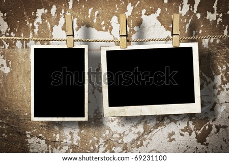Film Blanks Hanging on a Rope Held By Clothespins on a Grunge Background - stock photo