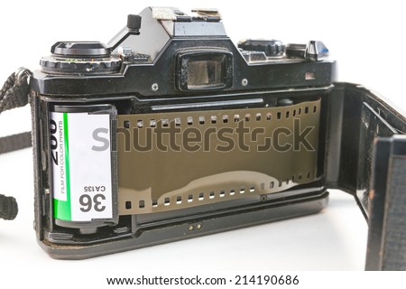 film camera with film loaded on white background  - stock photo