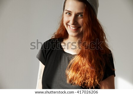 Film effect. Positive human face expressions and emotions. Young hipster redhead female with happy look, smiling after having got driver's license or passing successfully final exams at university  - stock photo