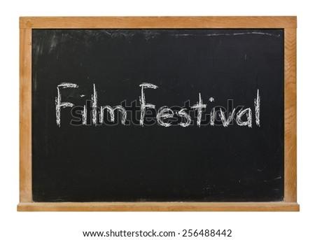 Film festival written in white chalk on a black chalkboard isolated on white - stock photo