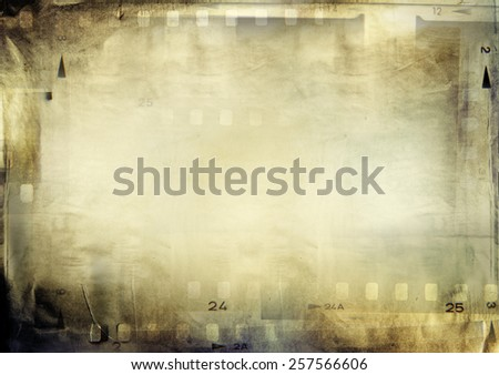 Film negative frames on grunge paper - stock photo