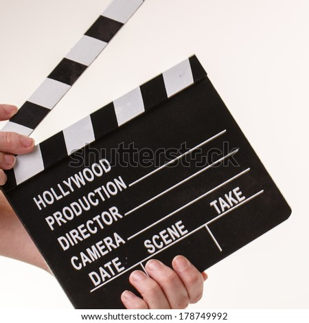 Film or Movie flapper in woman���´s hands on white background - stock photo