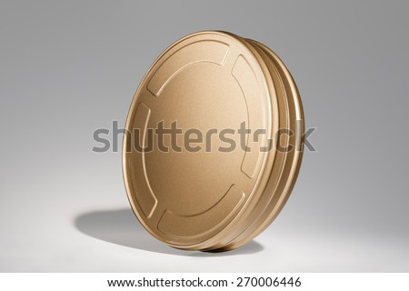 Film Reel Canisters Isolated on Grey Background with Real Shadow. Classic Gold Movie Film Can. - stock photo