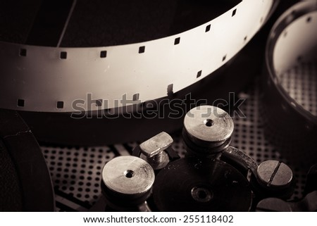 Film reel inside old-fashioned retro movie camera mechanism - stock photo