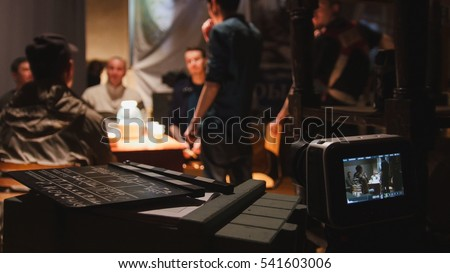 Film set - director, cinematographer and actors working on the cinema, wide angle