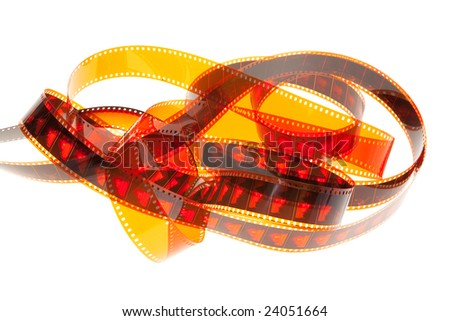 Film showing red shots of a landscape and a deer isolated in white background - stock photo