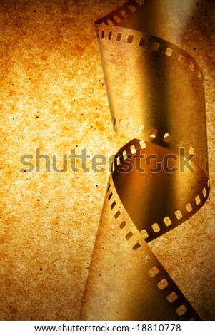 Film strip over grunge texture, may be used as background - stock photo
