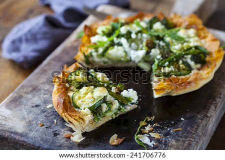 Filo pastry tart with asparagus, broccoli courgette and feta cheese - stock photo