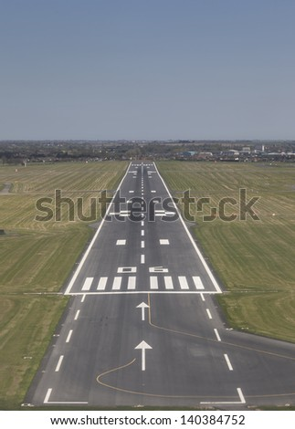 Final approach to land on a runway - stock photo