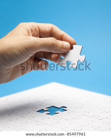 Final piece of puzzle - stock photo