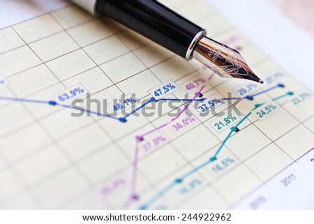 finance and business - financial graph in office - stock photo