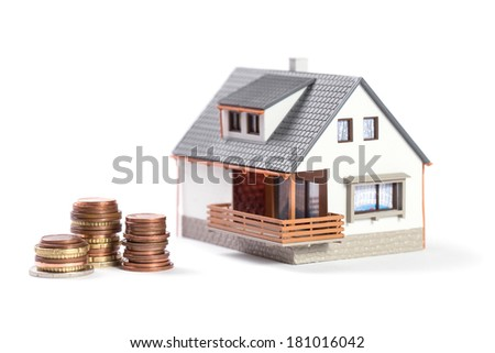 Finance and house expenses or investing concept. Beautiful house with coins. - stock photo