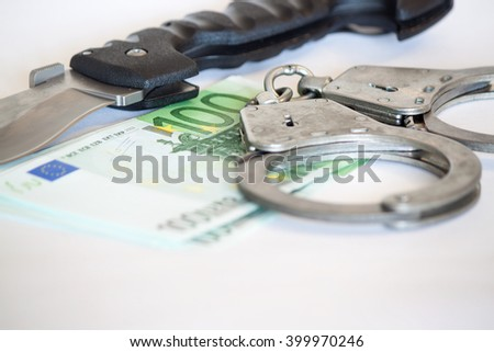 Finance and Law, economic crime, the punishment of the offender, pack of dollars, steel handcuffs, square image, finance and law, shadow capital, punishment crime. - stock photo