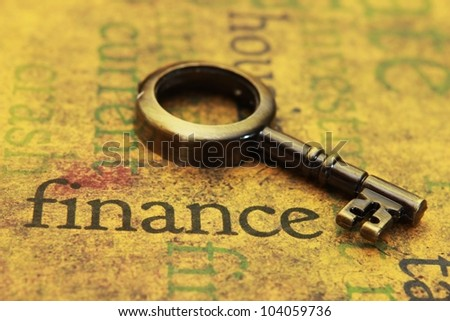 Finance and old key - stock photo