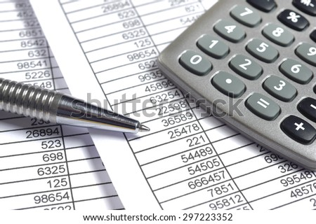 finance business calculation with table sheet and calculator - stock photo