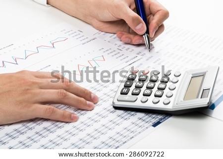 Finance, Calculator, Calculating. - stock photo