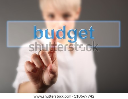 Finance concept - business woman touching screen with Budget sign - stock photo