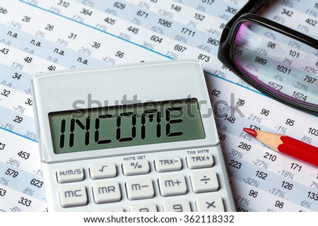 finance concept:income displayed on calculator
