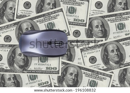 Finance concept, one hundred dollar banknotes under computer mouse. - stock photo