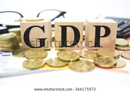 Finance Concept with Stack of Coins, GDP or Gross domestic product written