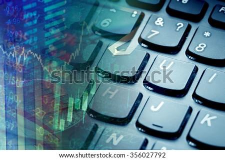 Finance data and computer keyboard. - stock photo